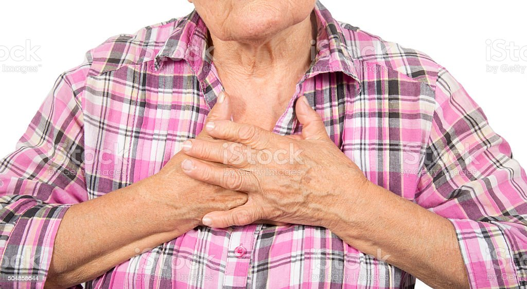 Senior woman having chest pain royalty-free stock photo