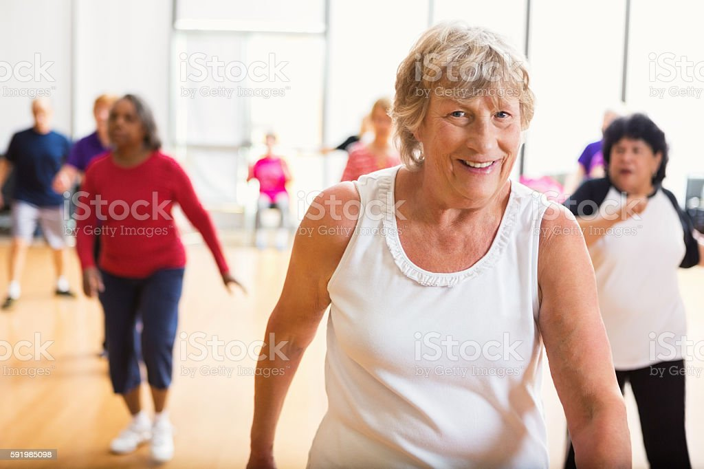Senior woman having fun at senior center stock photo