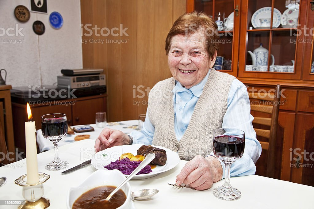 senior woman having lunch royalty-free stock photo