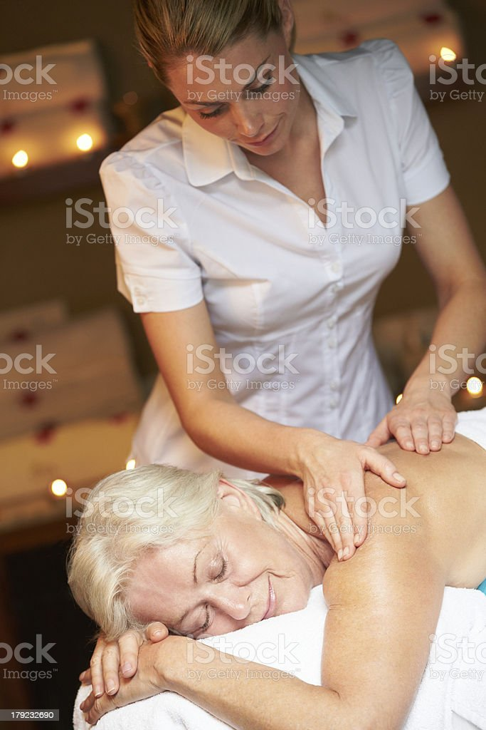 Senior Woman Having Massage In Spa royalty-free stock photo