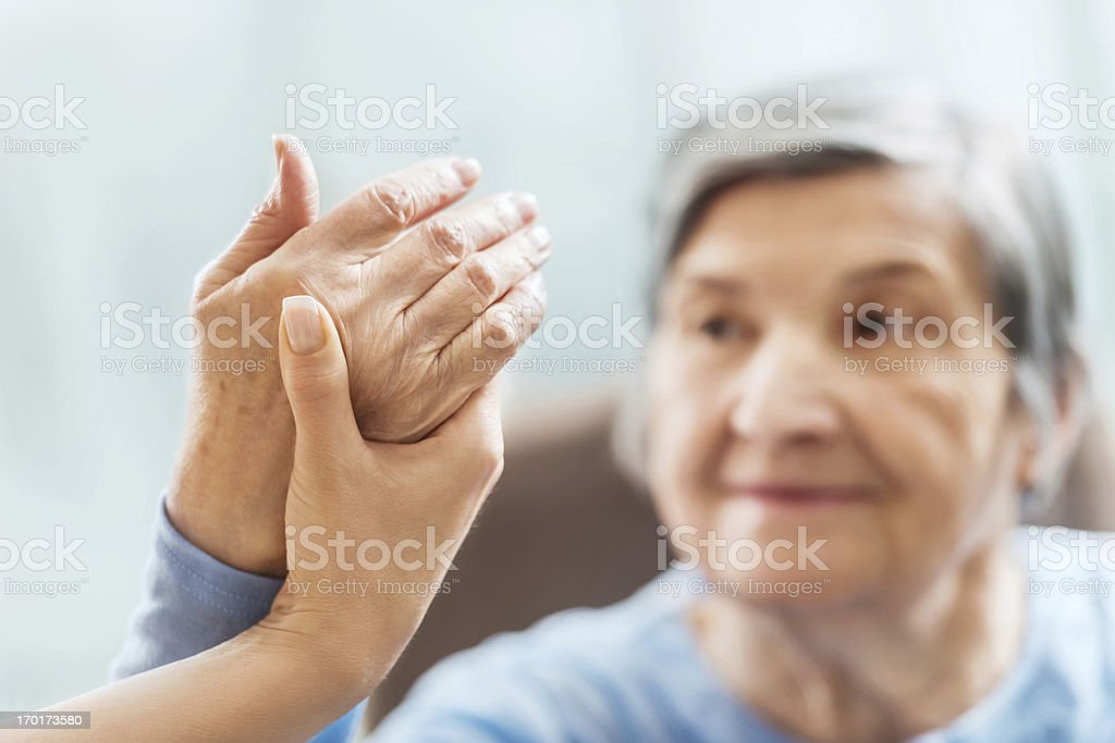 Senior woman having physical therapy. stock photo