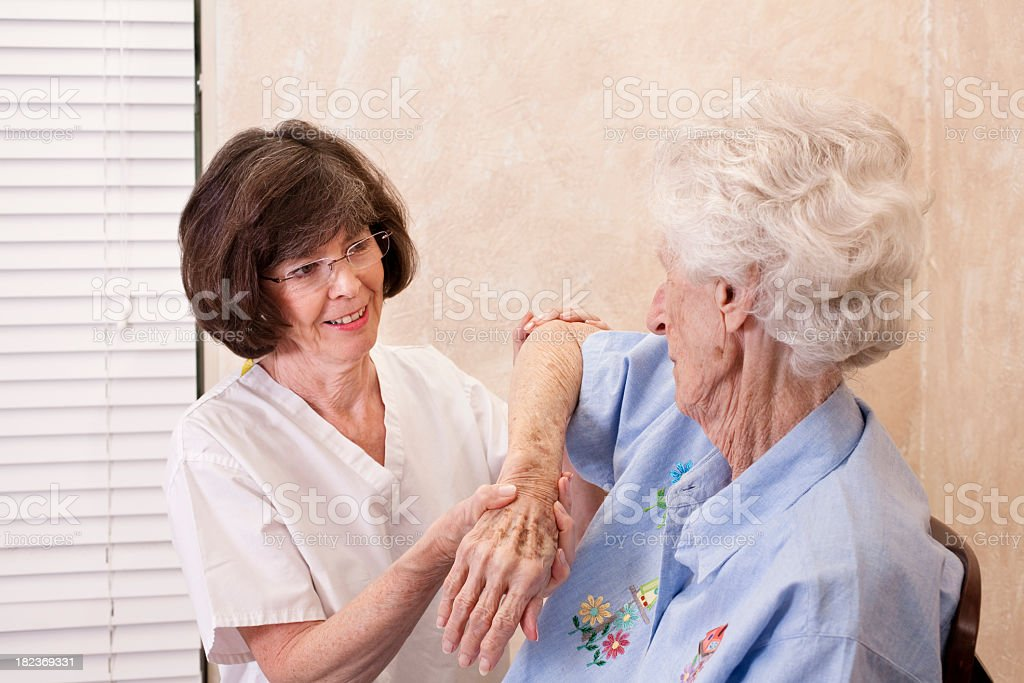 Senior woman having physical therapy royalty-free stock photo