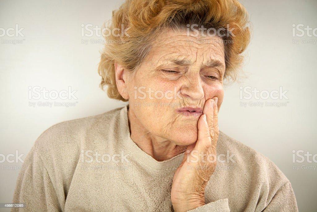 Senior woman having teeth ache stock photo