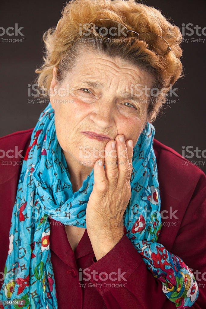 Senior woman having tooth ache stock photo