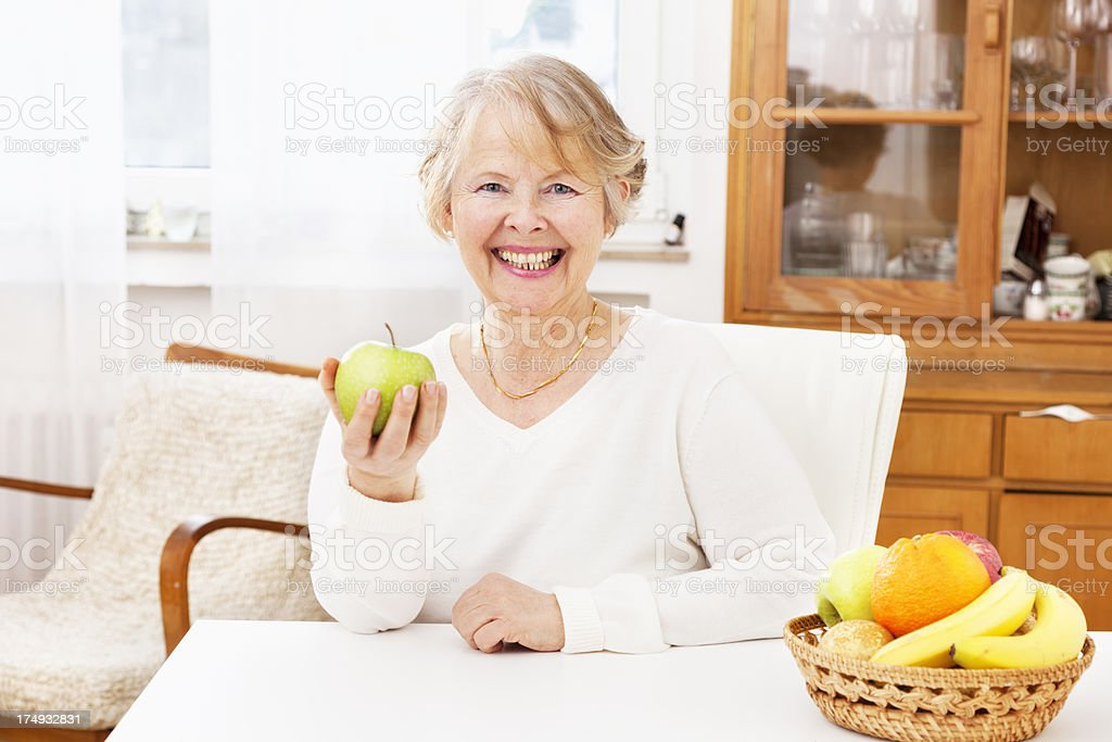 senior woman healthy eating fruit apple happiness royalty-free stock photo