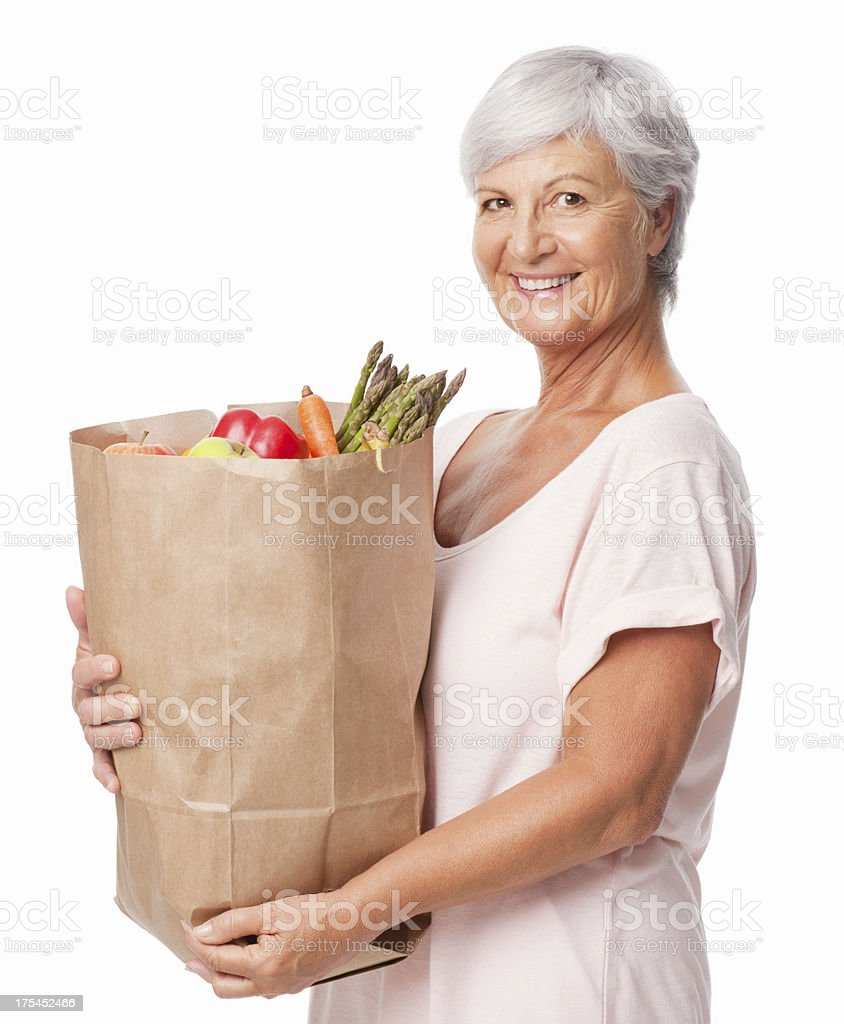 Senior Woman Holding a Bag Of Fresh Groceries - Isolated royalty-free stock photo