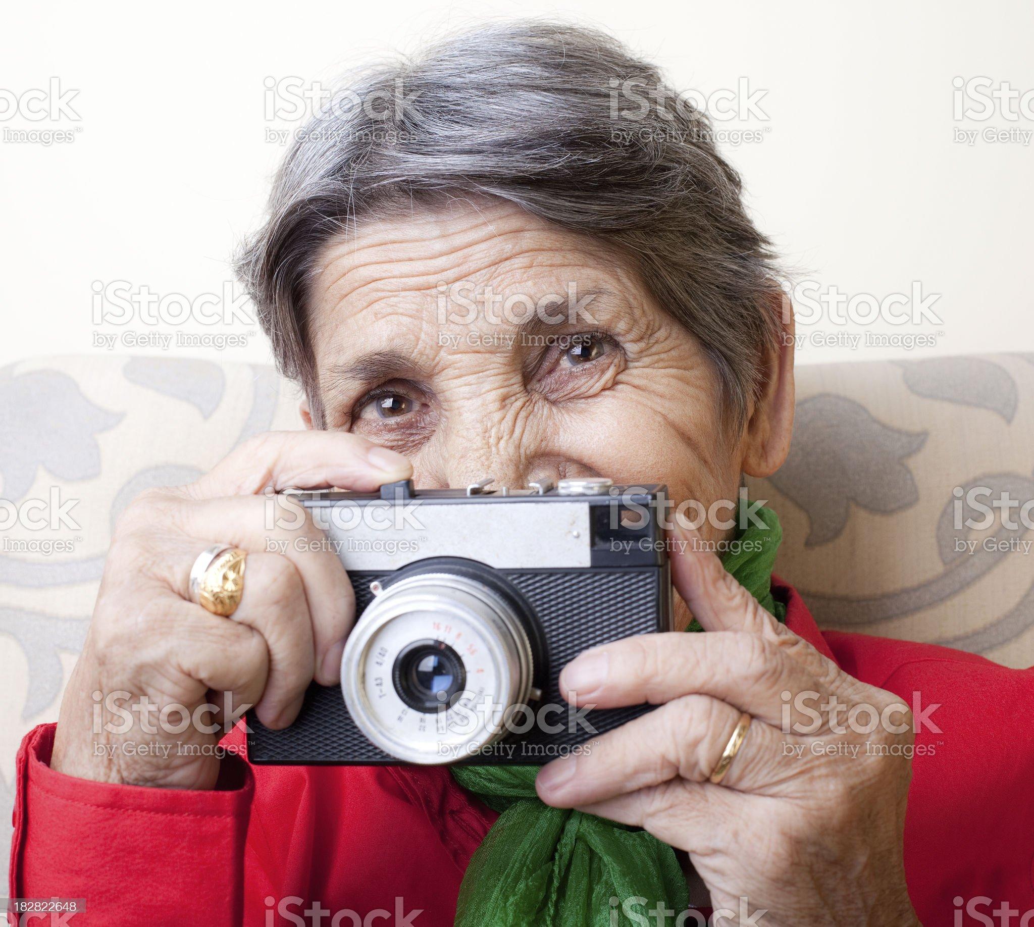 Senior woman holding a camera royalty-free stock photo