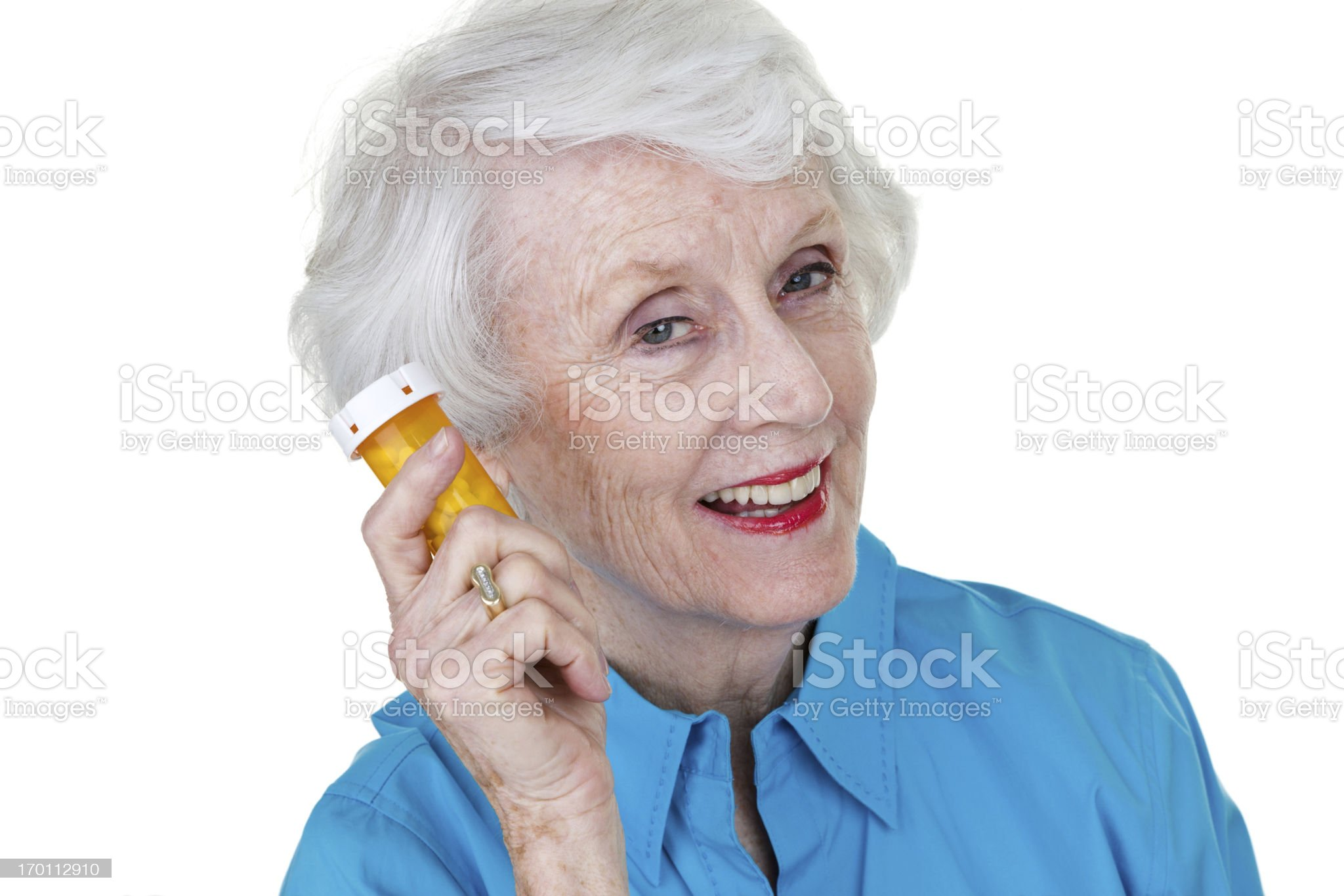 Senior woman holding a medicine container royalty-free stock photo