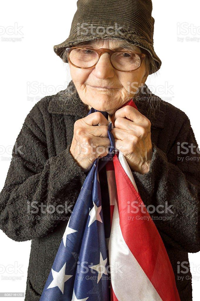 Senior woman holding an American flag. stock photo