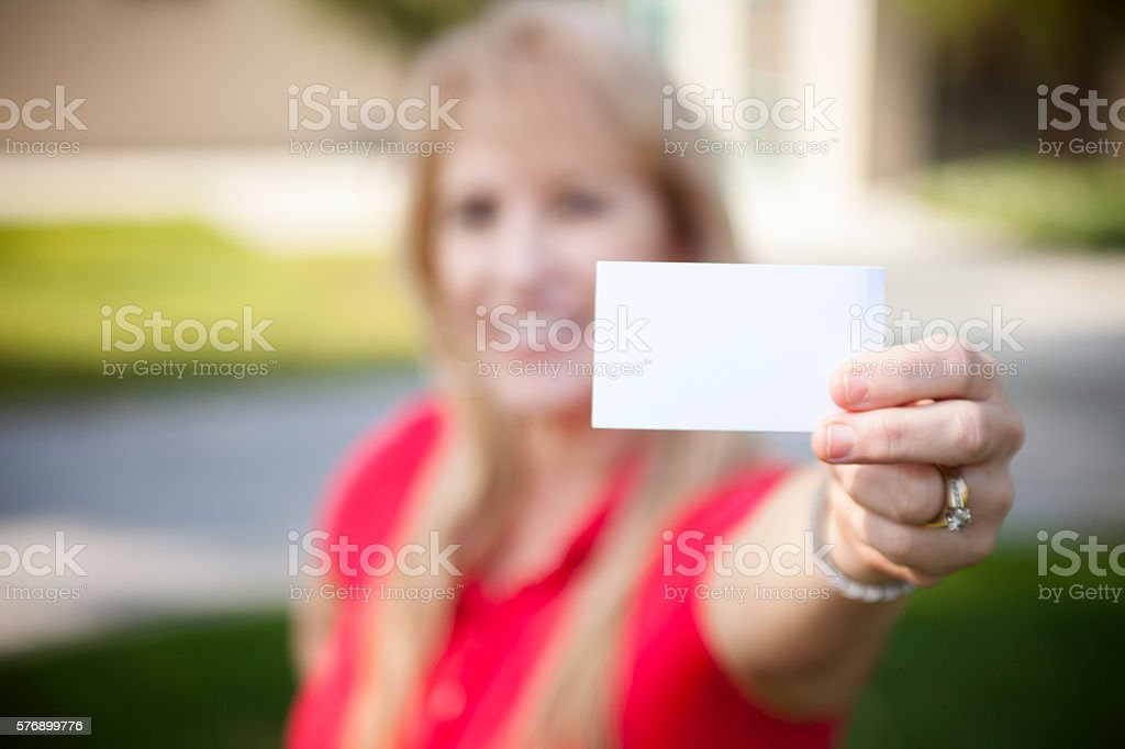 Senior Woman holding Blank Card stock photo