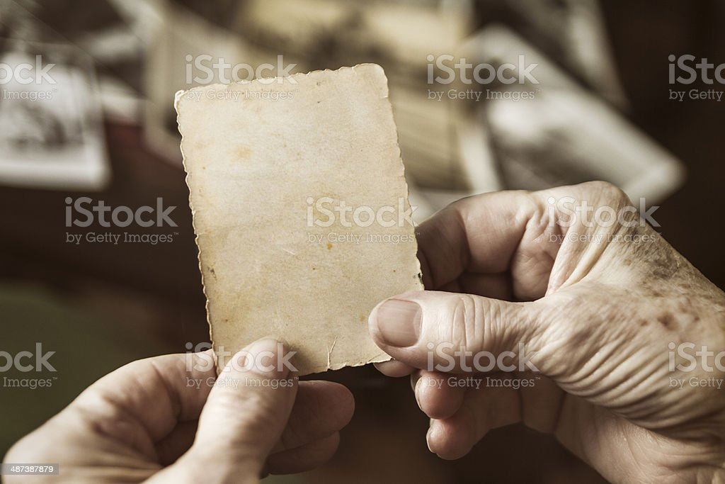 Senior woman holding blank vintage photograph royalty-free stock photo