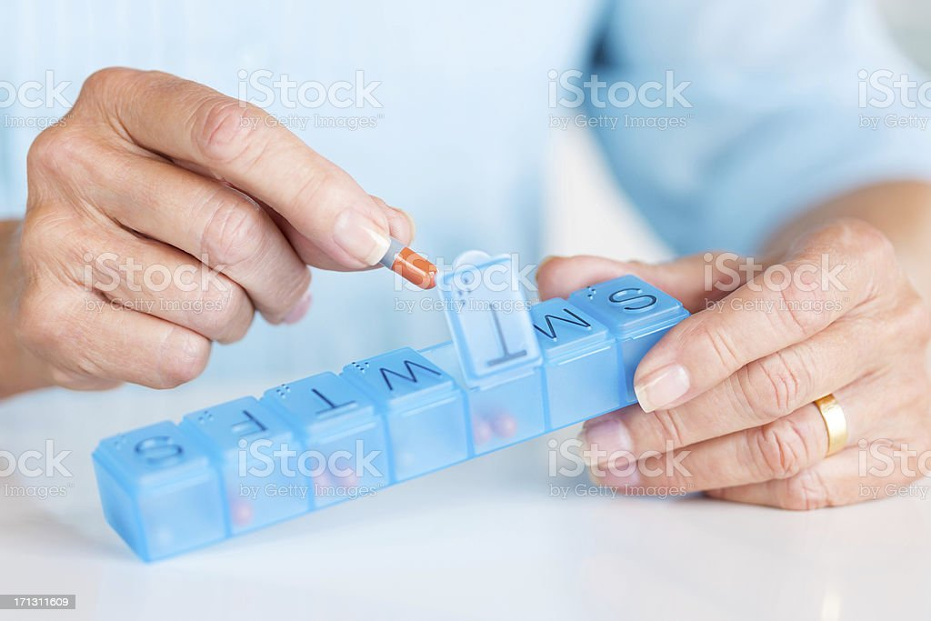 Senior Woman Holding Daily Pill Container. stock photo