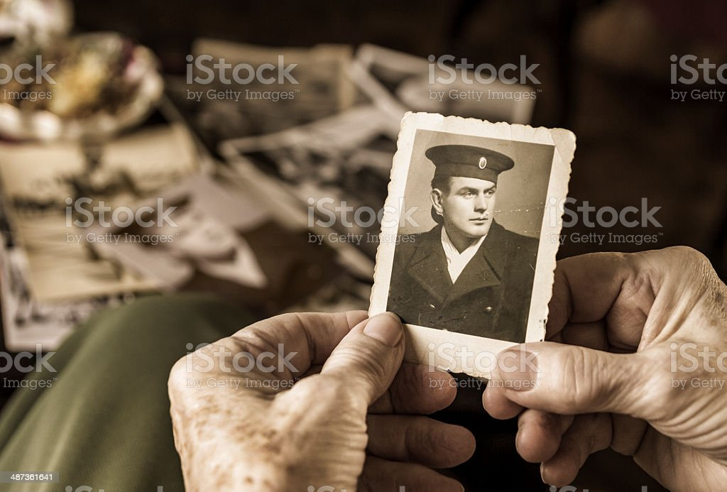 Senior woman holding dear photograph of her husband royalty-free stock photo