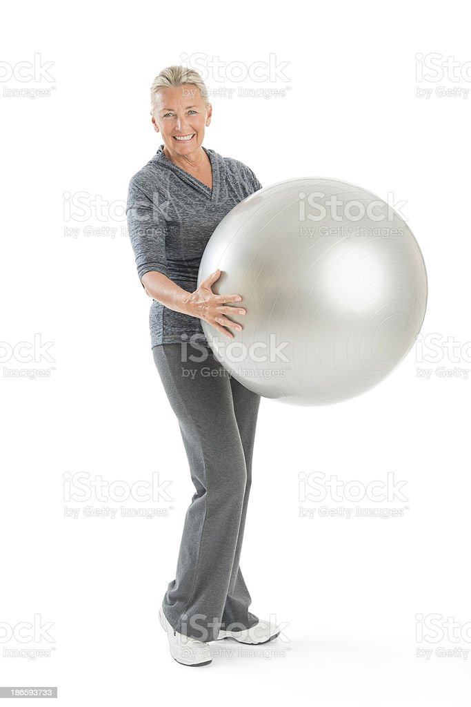 Senior Woman Holding Fitness Ball royalty-free stock photo