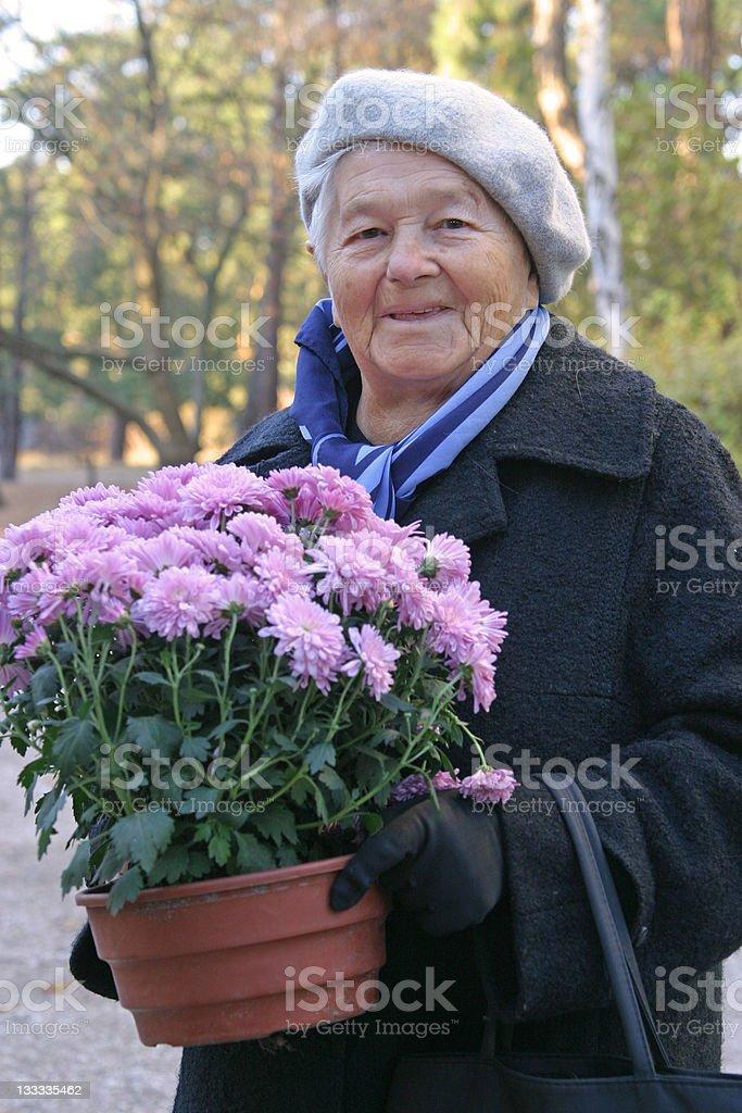 Senior woman holding flower. royalty-free stock photo