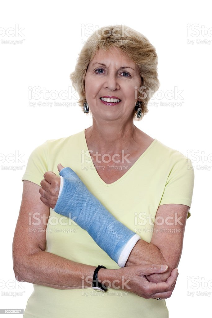 Senior woman holding injured arm in cast royalty-free stock photo