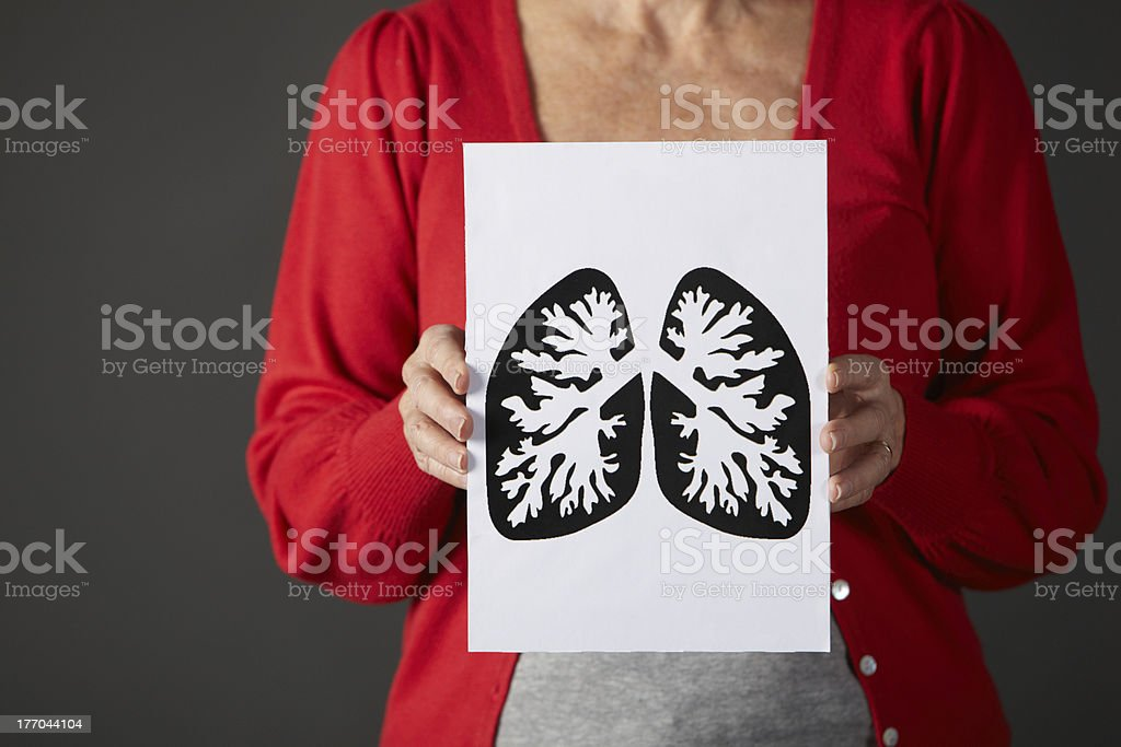 Senior woman holding ink drawing of lungs stock photo