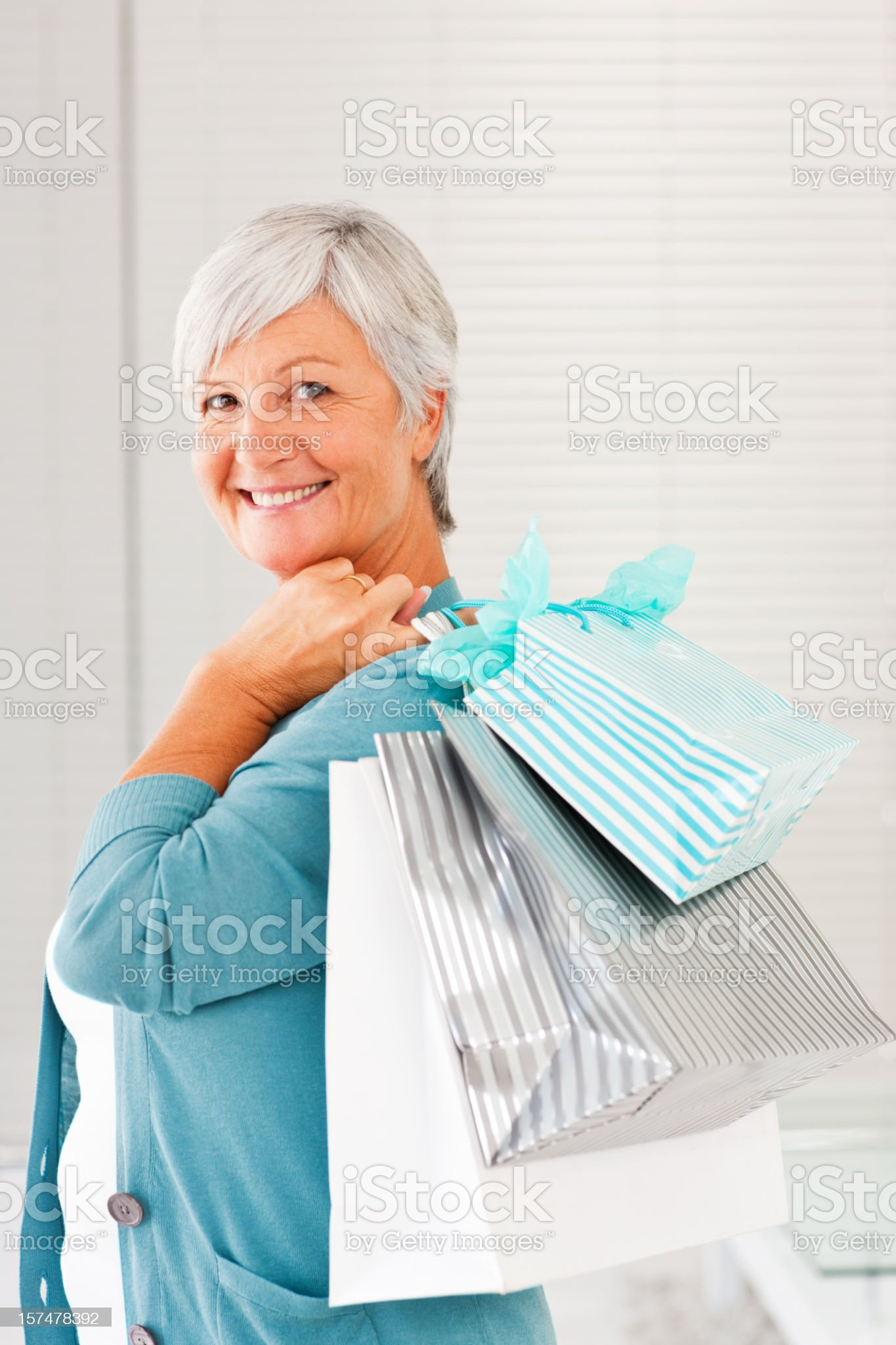 Senior woman holding shopping bags royalty-free stock photo