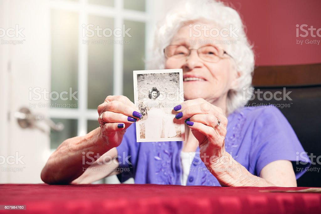Senior Woman Holding Teenage Photo stock photo