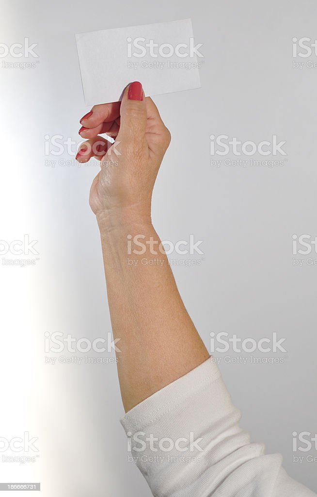 Senior woman holding up a blank card. royalty-free stock photo