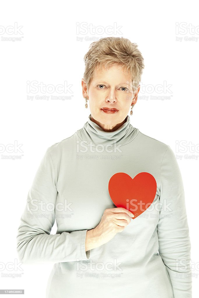 Senior Woman Holding up a Red Heart. Isolated. royalty-free stock photo