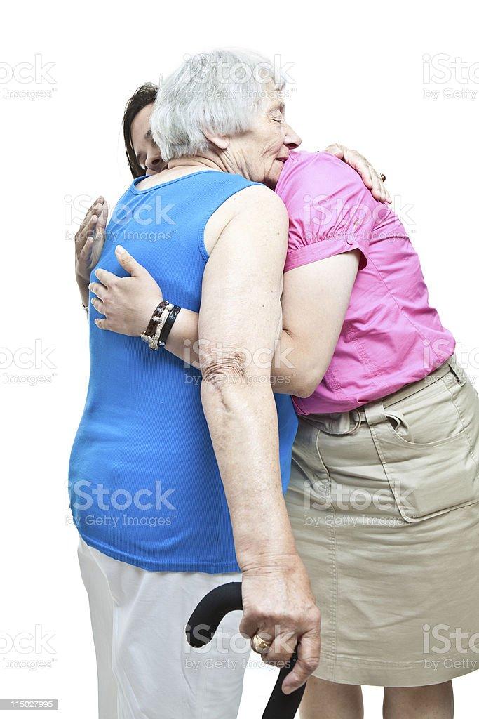 Senior Woman Hugging Granddaughter stock photo