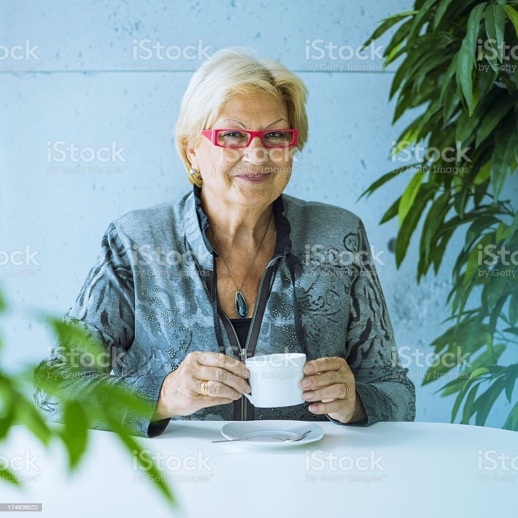 Senior woman in a coffee break royalty-free stock photo