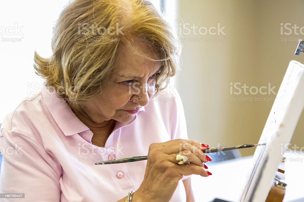 Senior woman in art class stock photo