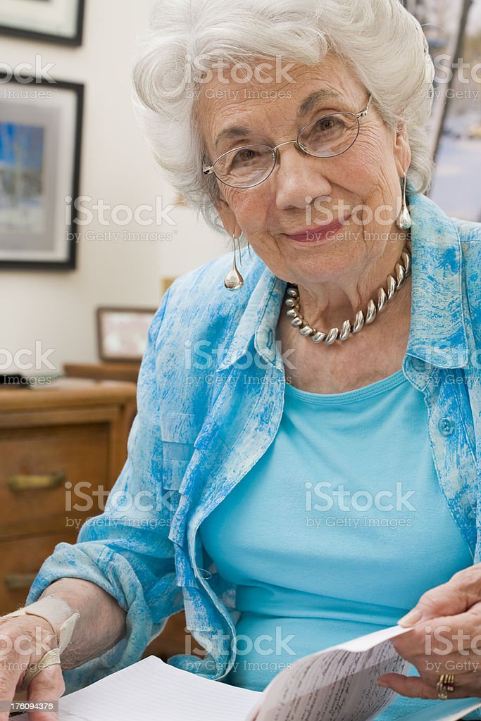 senior woman in blue blouse royalty-free stock photo