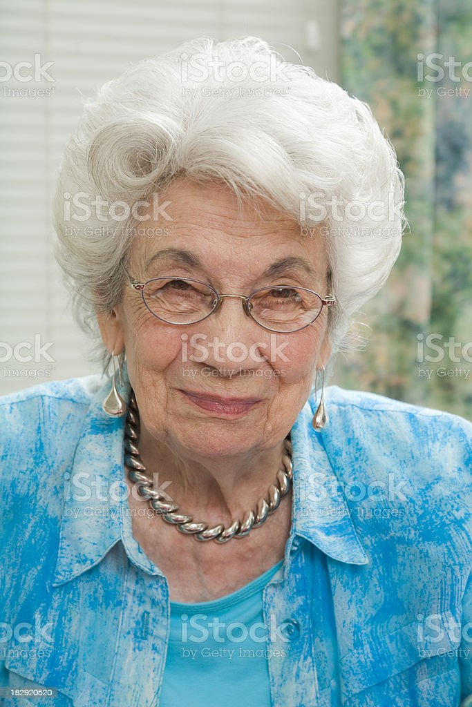 senior woman in blue blouse stock photo