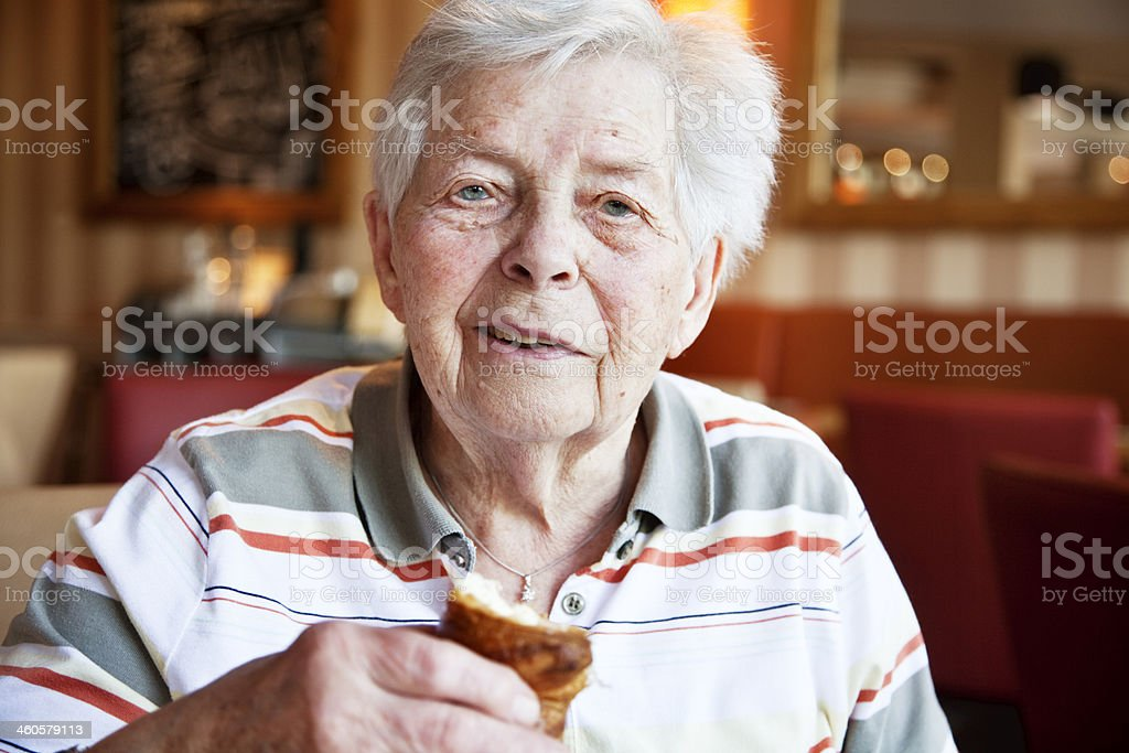 senior woman in cafe royalty-free stock photo