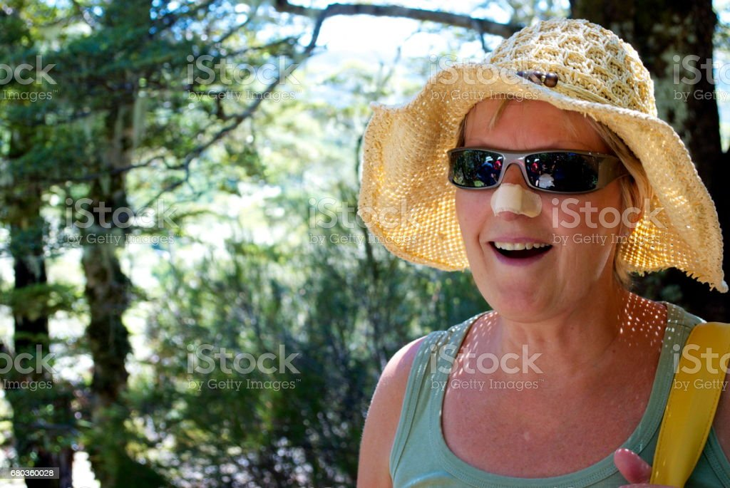 Senior Woman in Forest, Summer stock photo