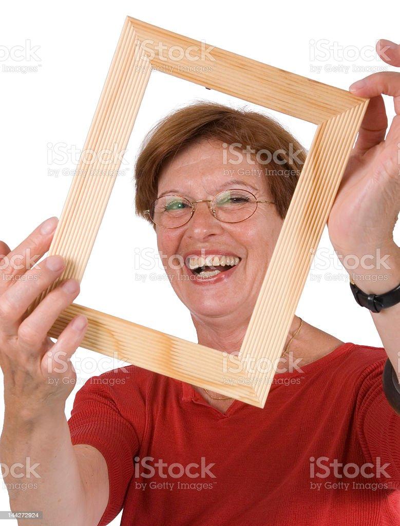 senior woman in frame stock photo