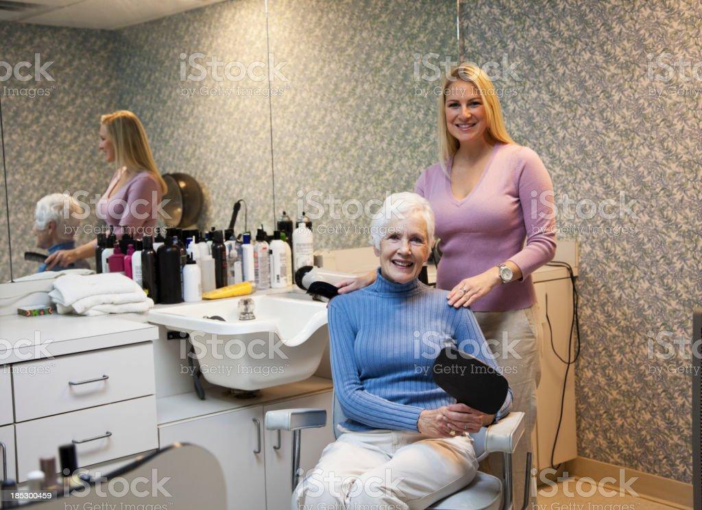 Senior woman in hair salon stock photo