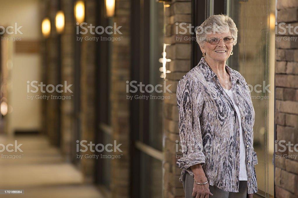 Senior woman in hallway royalty-free stock photo