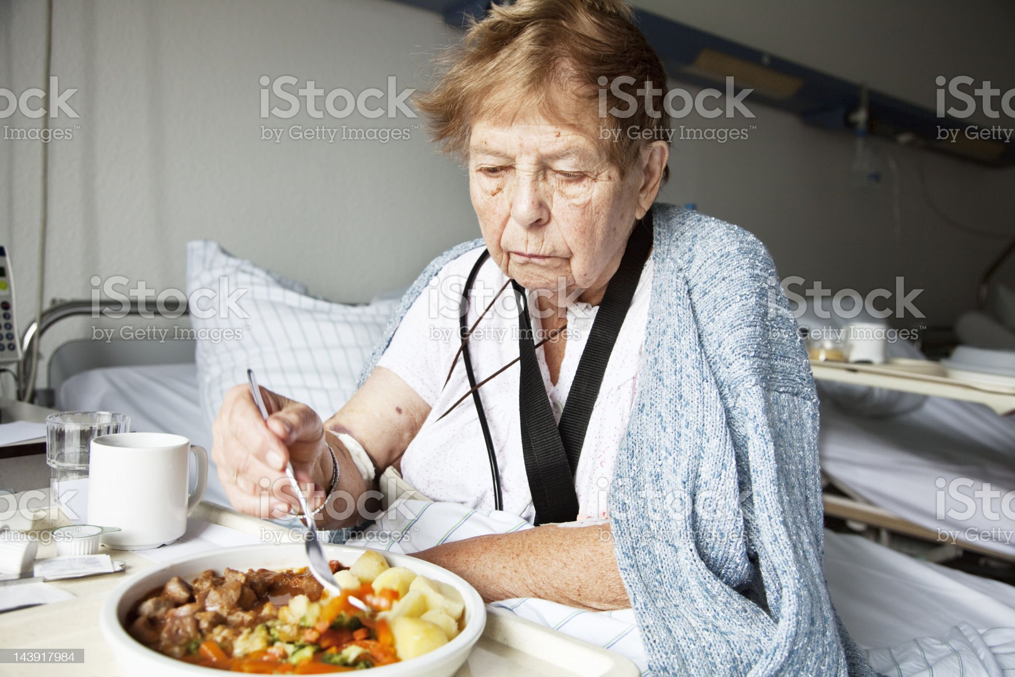 senior woman in hospital eating royalty-free stock photo