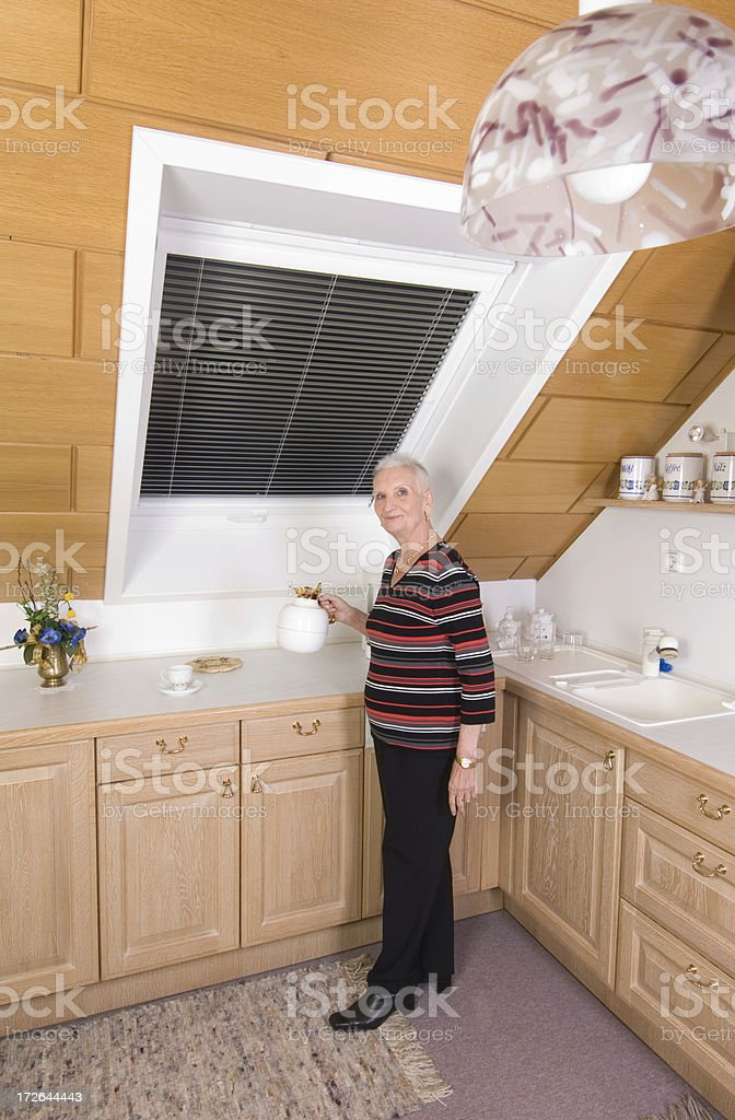 Senior woman in kitchen royalty-free stock photo