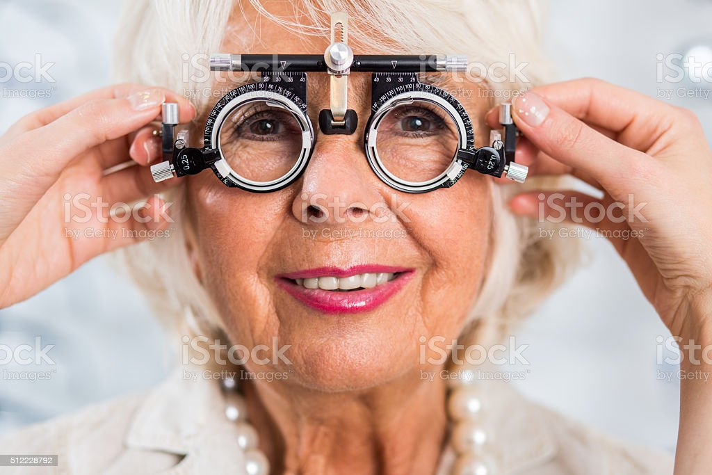 Senior woman in optician's office stock photo