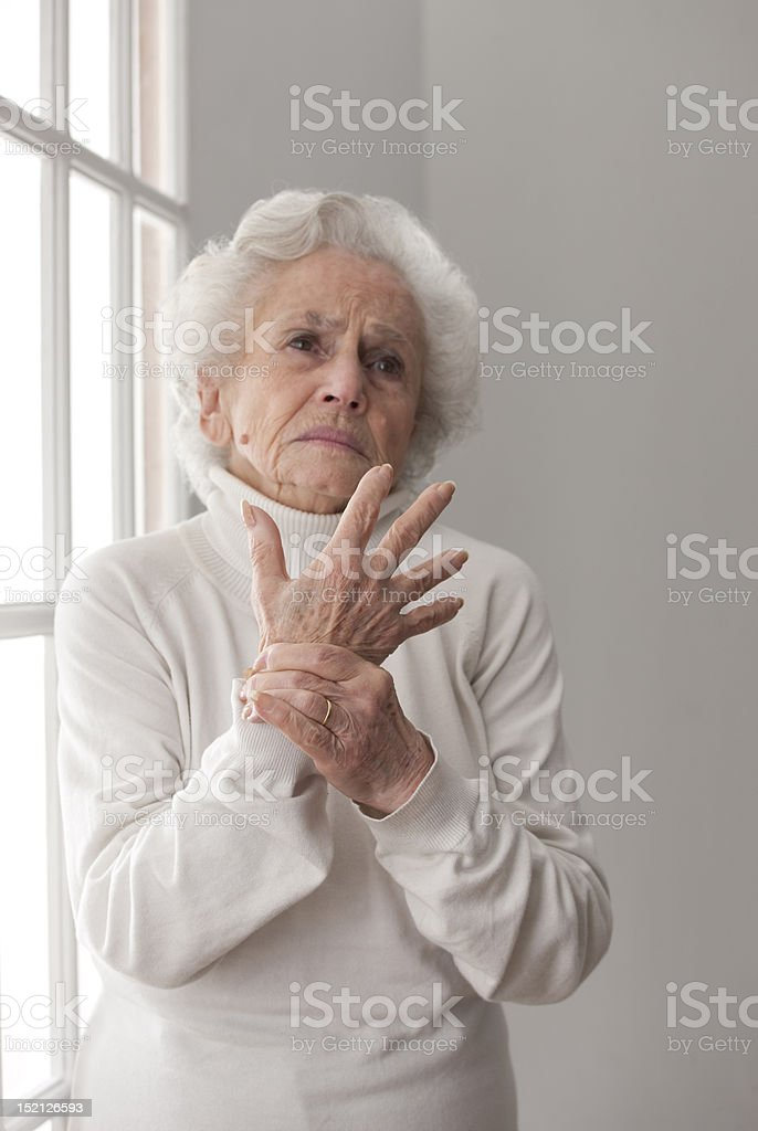Senior woman in pain royalty-free stock photo