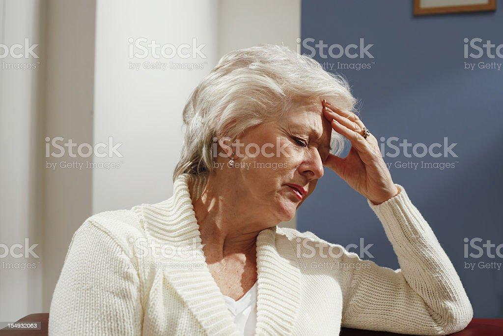 senior woman in pain royalty-free stock photo