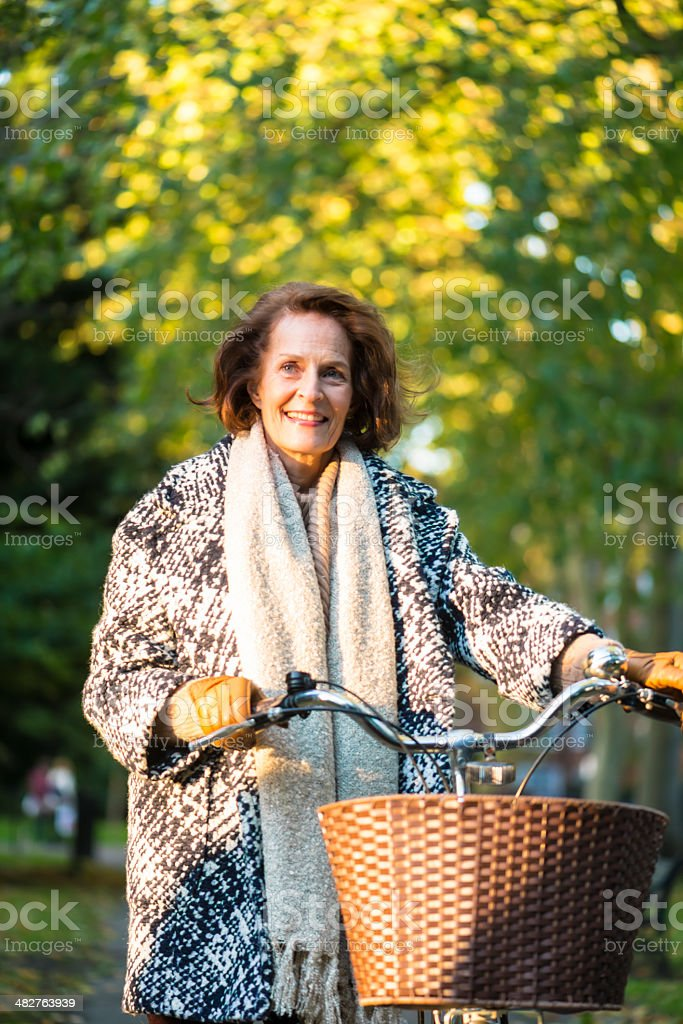 Senior woman in park royalty-free stock photo