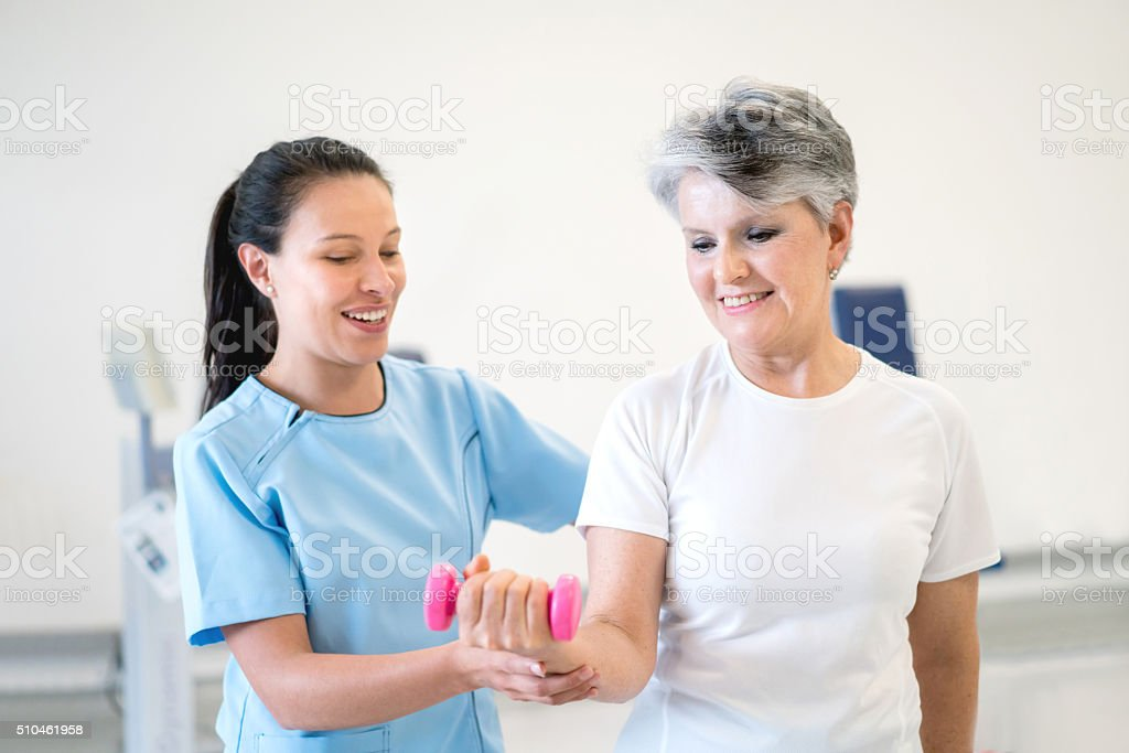 Senior woman in physiotherapy for her wrist stock photo
