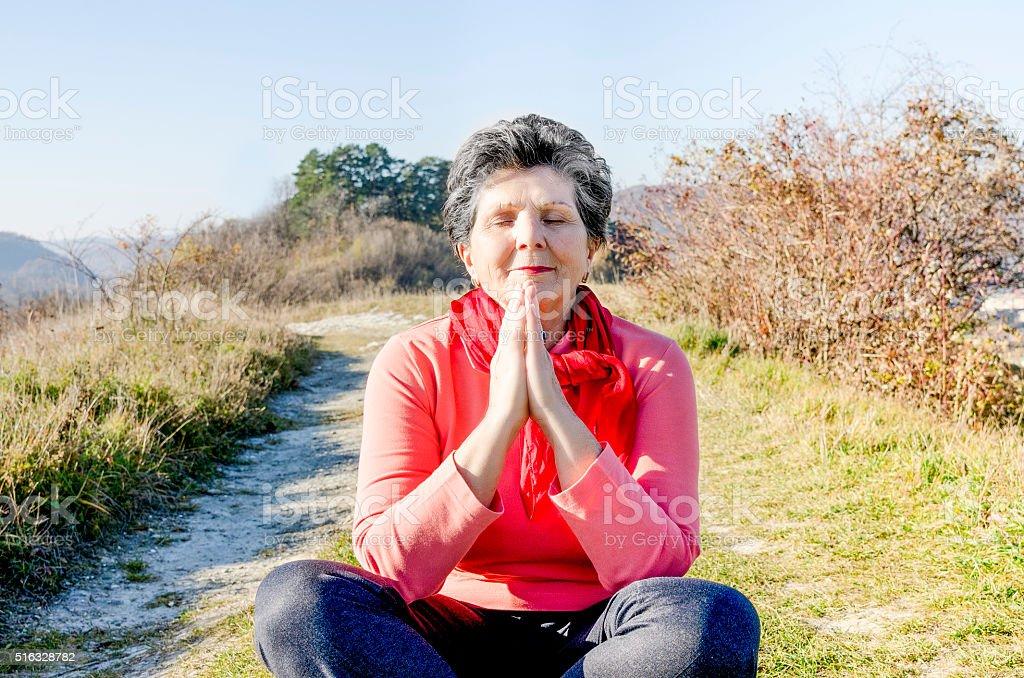 Senior Woman in Prayer stock photo