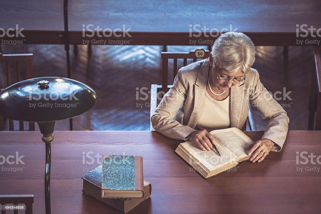 Senior woman in public library stock photo