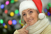 Senior woman in Santa hat