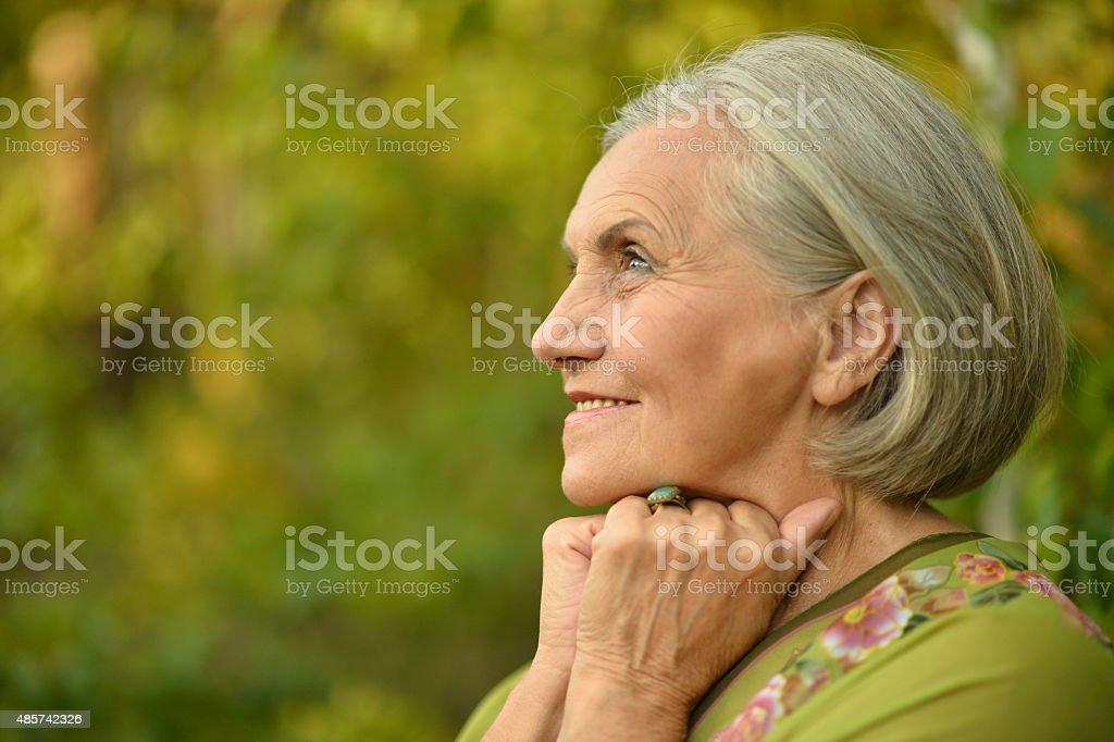 Senior woman in summer park stock photo