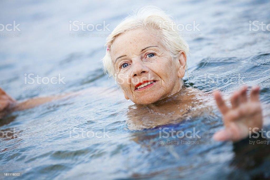 Senior woman in swimming pool royalty-free stock photo