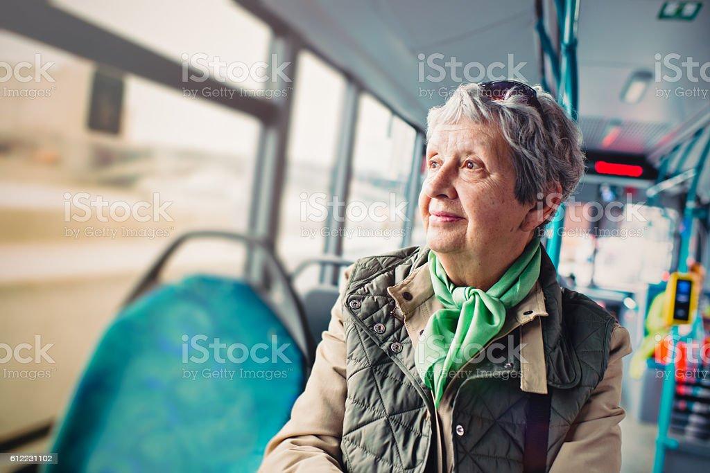 Senior woman in the bus stock photo