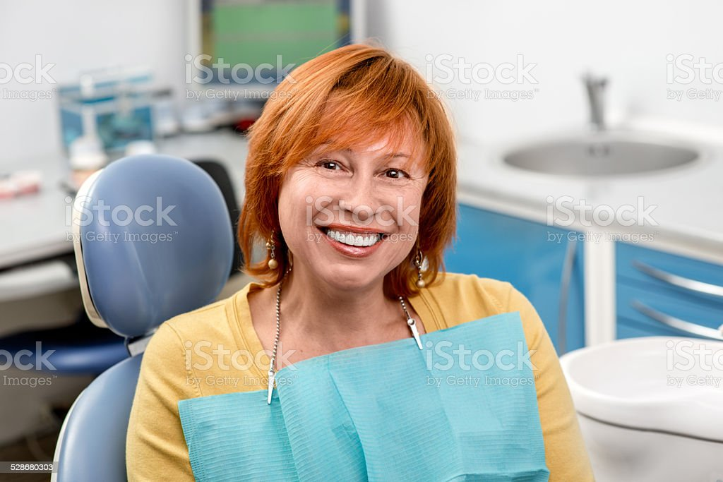 Senior woman in the dental office. stock photo