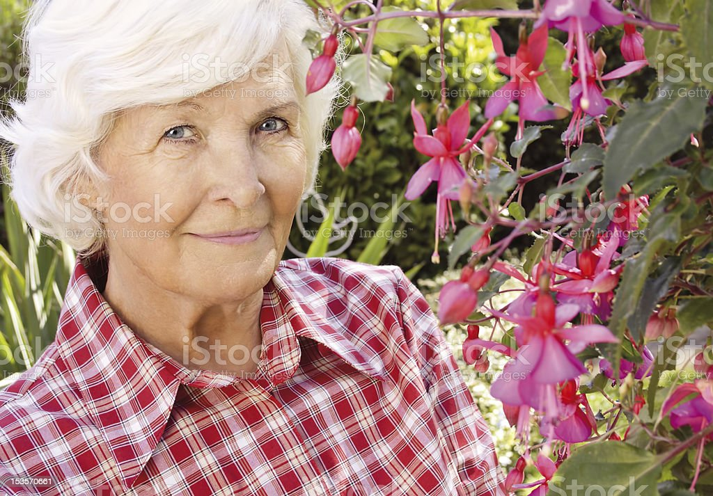 Senior woman in the garden royalty-free stock photo